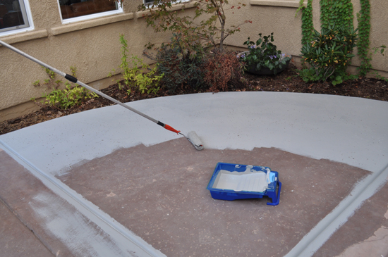Painting the Surface with a Roller for The Design Confidential Patio Rescue and Resurface Project