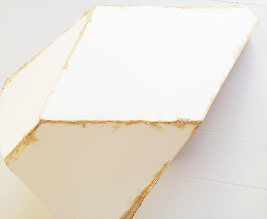 Fill Seams with Wood Filler for The Design Confidential DIY Over-Sized Geometric Lamp Project Using Mat Board