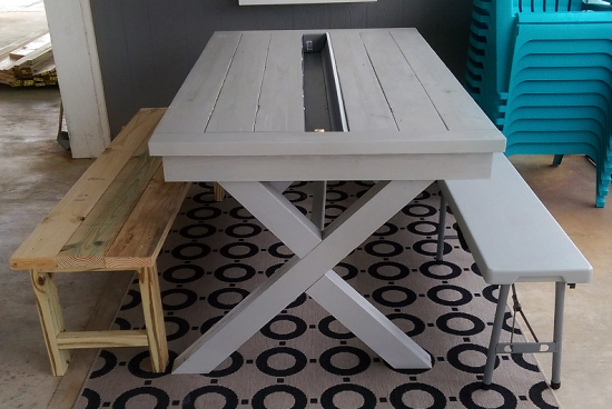 The Design Confidential Builders Showcase // Rustic Outdoor Table with Built In Drink Cooler via @thedesconf