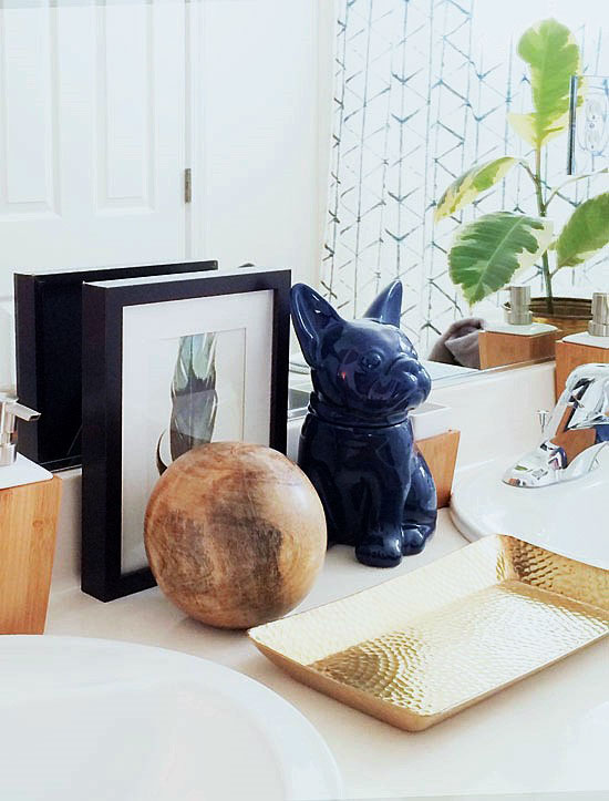 Blue Ceramic French Bulldog Cookie Jar Hammered Metal Tray Brass Wooden Sphere Bamboo Soap Dispenser for The Design Confidential New Year New Beginnings // A Shared Bath for the Boys