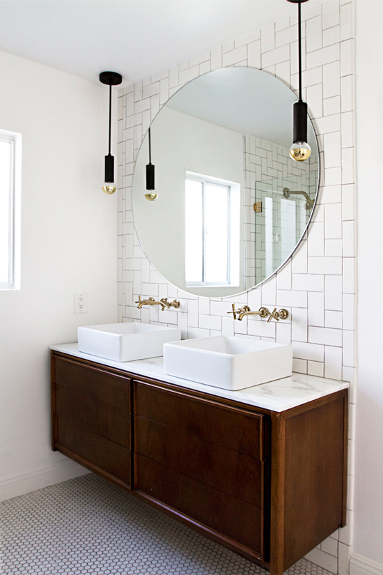 The Design Confidential Bathe Well Rounded Mirrors in the Bath Smitten Studio Bathroom Round Mirror Floating Credenza Vintage Herringbone Tile Pendant Lights
