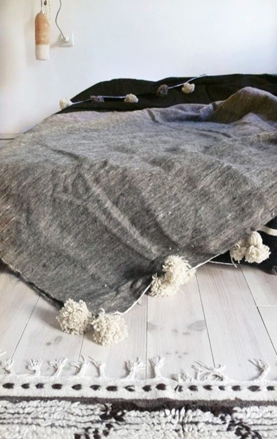 Oversized Moroccan Wool Blanket with Pom Poms for The Design Confidential Currently Crushing The Unmade Bed