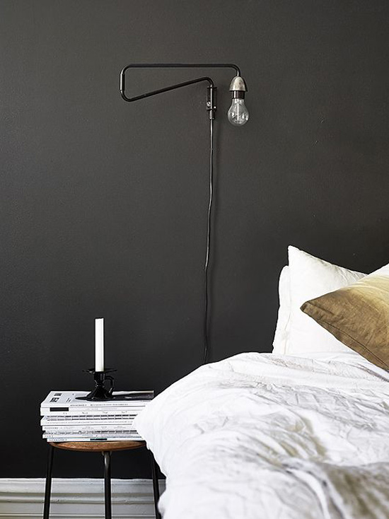 Black Walls White Bedding and Minimal Tube Light Sconce for The Design Confidential Currently Crushing The Unmade Bed