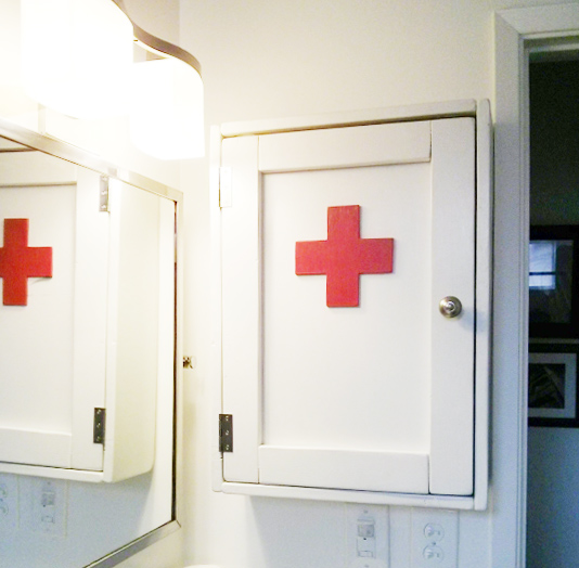 Reader Showcase // Simple White Medicine Cabinet with Red Cross