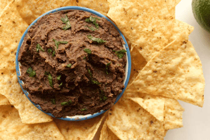 This black bean dip is deliciously healthy and simple. Plus, every serving has 10g of protein, and is less than 150 calories! #Healthy #Recipe