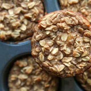 A banana oatmeal breakfast muffin on a muffin tin.