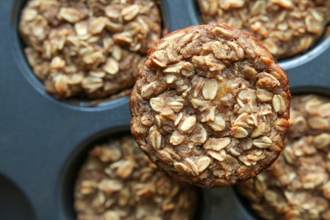 A banana oatmeal breakfast muffin on a muffin tin.