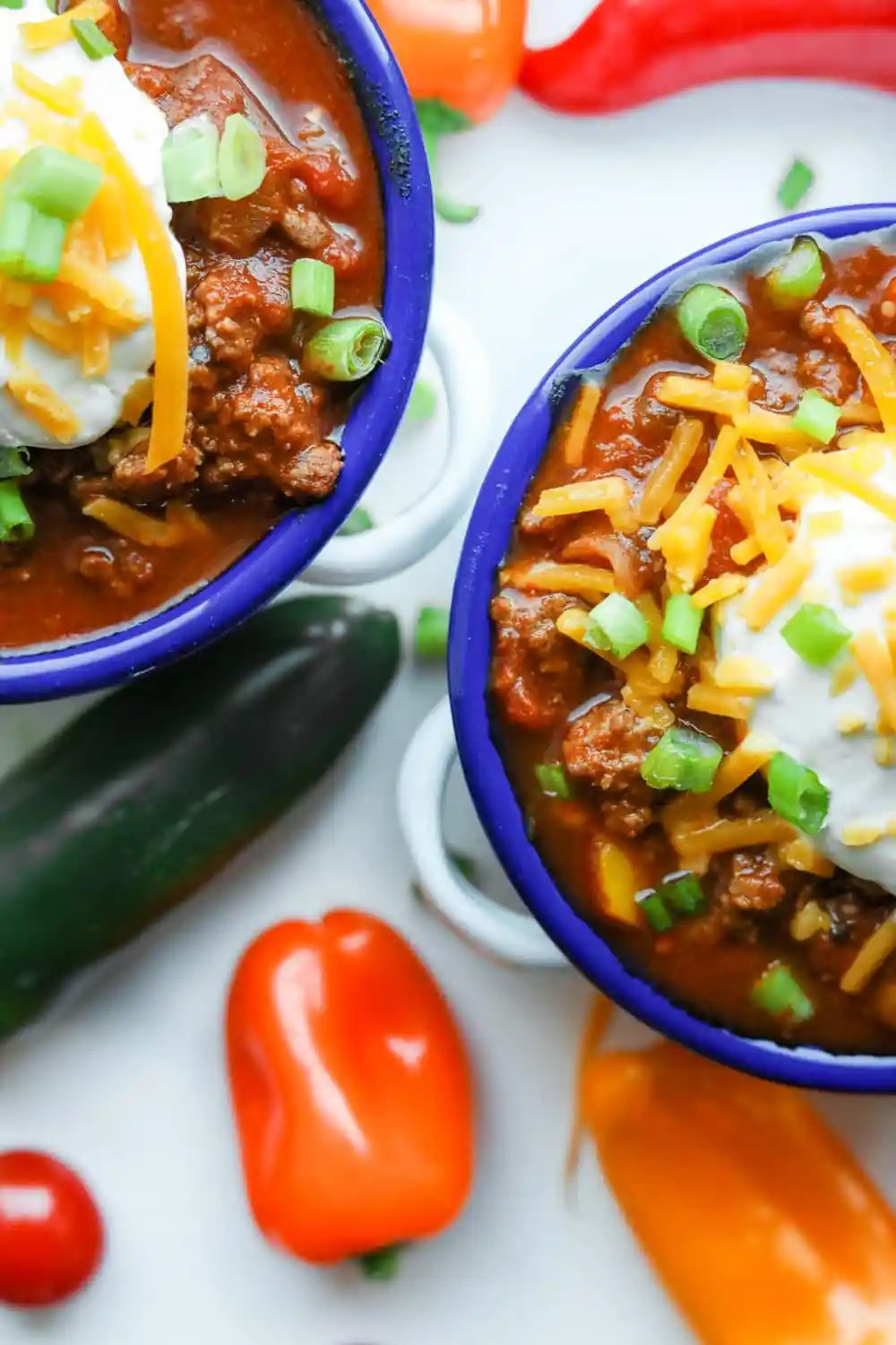 2 Bowls of chili next to each other.
