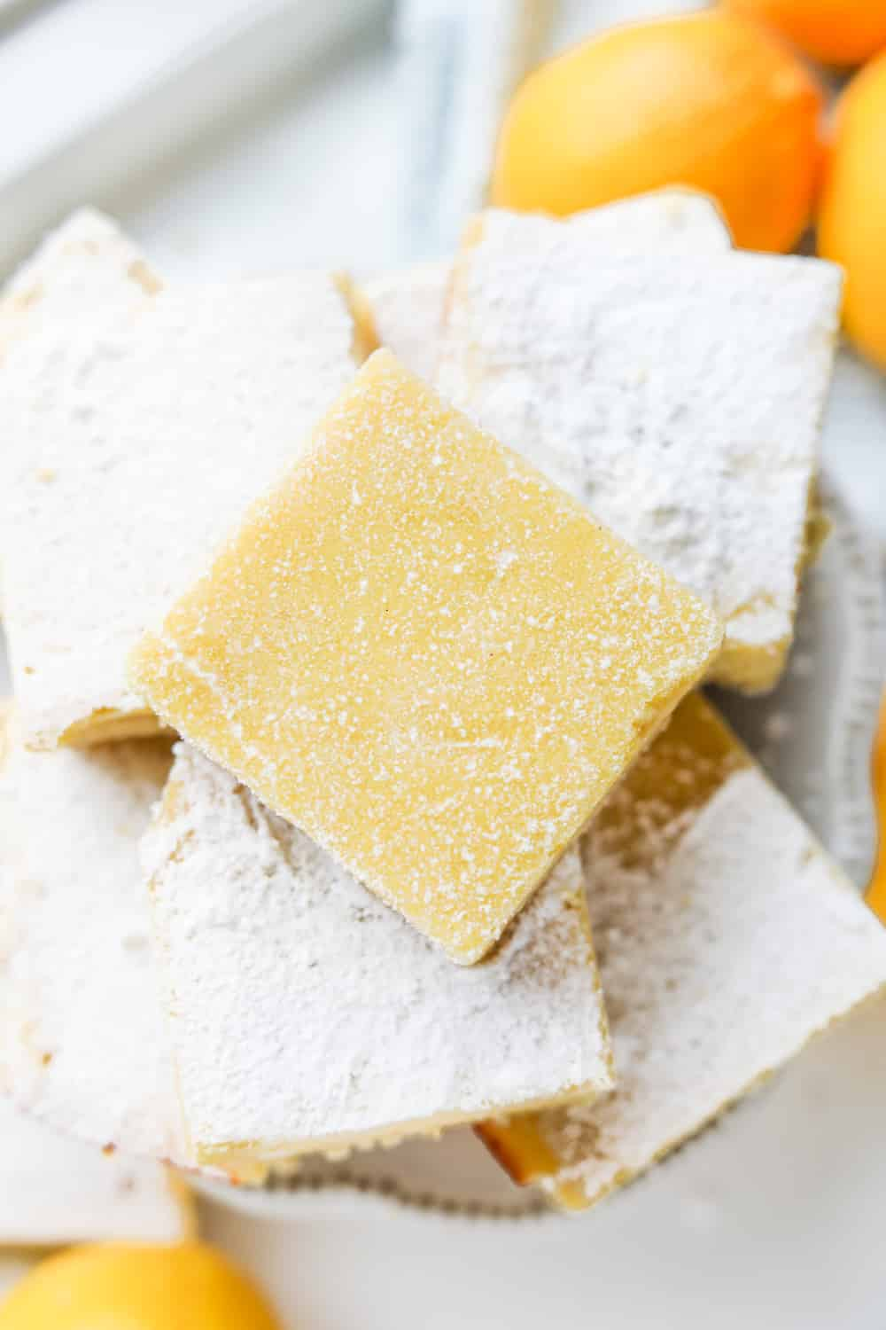 Lemon bars stacked on top of one another.