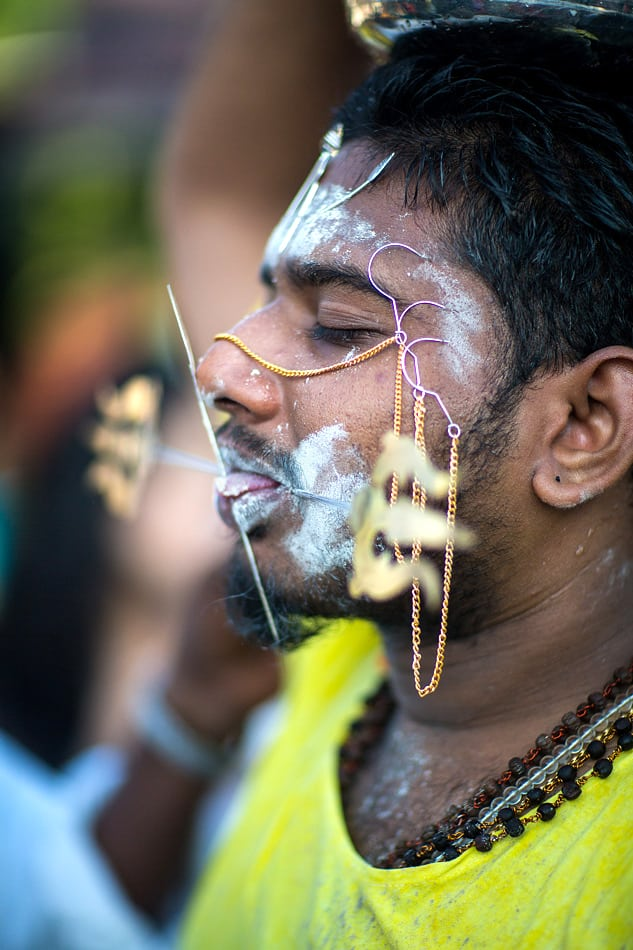 Tongue and cheek as well as other parts of his face are pierced with the vel.
