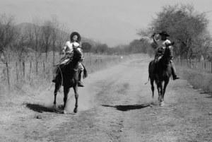 Gauchos having fun on horses in Argentina