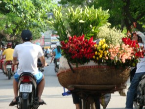 Motorcyclist with flowers in a basket,, Hanoi