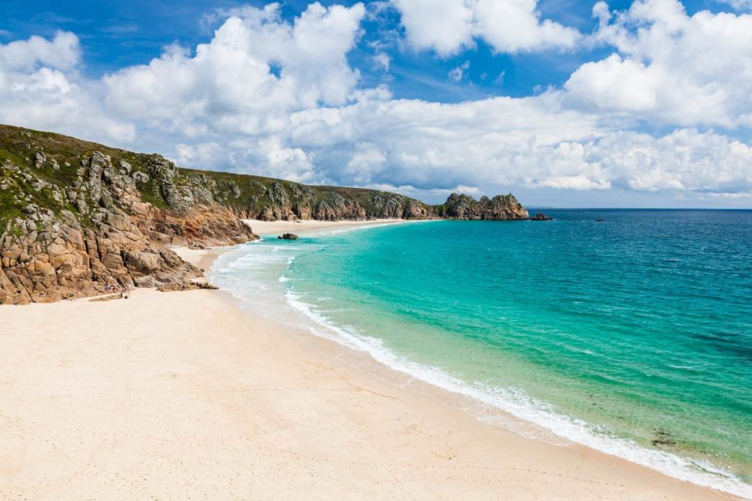 Porthcurno in Cornwall is an awesome sandy beach in the UK