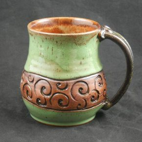 carved ceramic mug