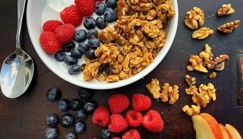 Greek yogurt topped with granola and fruit