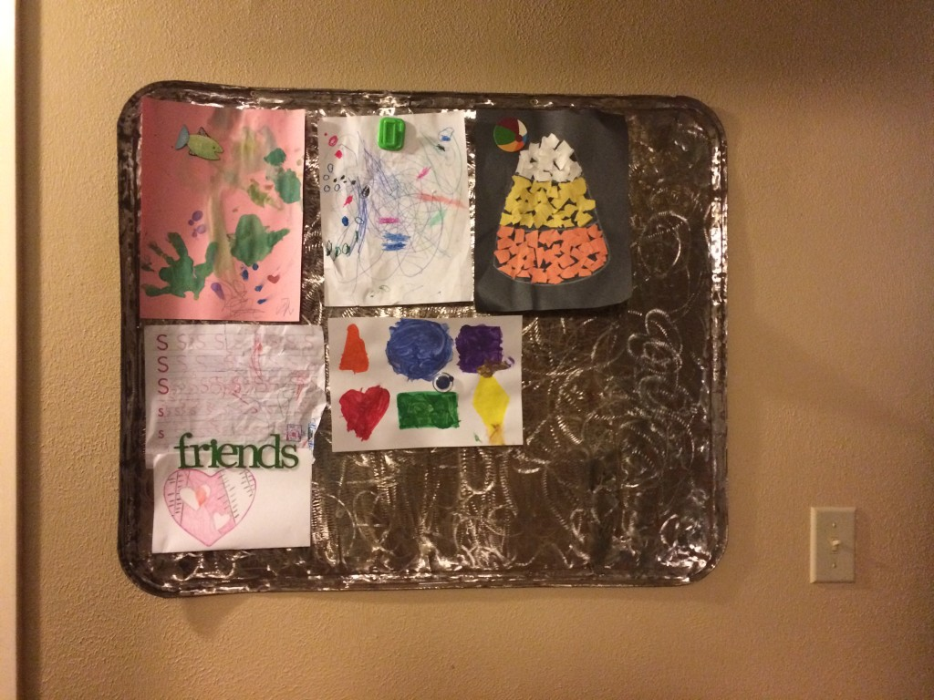 Distressed Metal: Magnetic Children's Art Display Board | A Domestic Wildflower click through to read this helpful and thorough tutorial for how to take junk metal and make a beautiful display board!