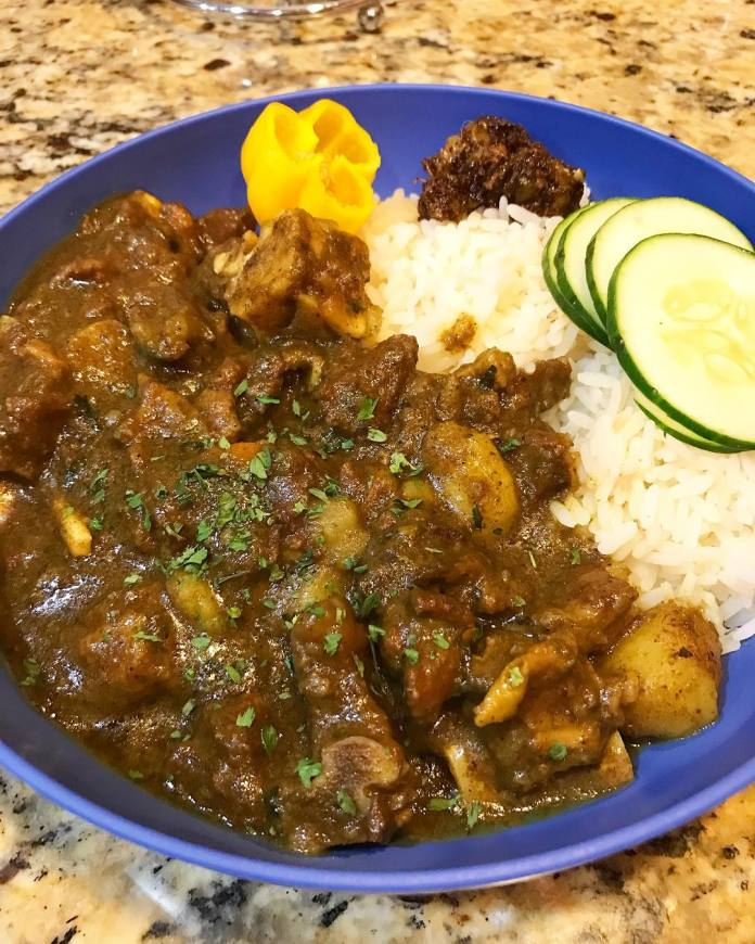 Making curry goat