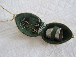 Inside the 1930s traveling sewing kit - all original items still intact - from Treasury (Washington, D.C.).