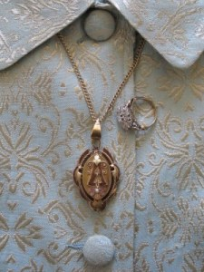 My lola's locket and the ring my grandparents gave to my mother.