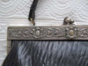 Ornate silver frame and textured pigskin leather.