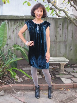 Supermom wears sparkly tights, an ombre velveteen shift, and ruffled booties.