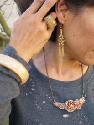 A Gorgeous and Green find - a rose necklace made from corn! (Earrings by Carmela Rose and ring from Lava 9, Berkeley, CA)