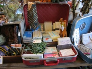 Vintage suitcases hold unique gifts and treasures.