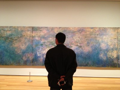 "Capturing the quiet admiration of an art lover: My ""Magritte-esque"" photograph of Monet's water lilies."