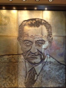 "A photo-engraved magnesium mural of ""A Generation of Presidents"" includes LBJ in the Great Hall o the 4th floor."