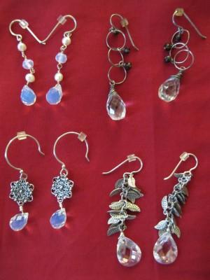 A mixture of opalite, Swarovski crystal, quartz crystal, smoky quartz, and sterling silver.