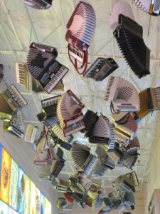 Accordions are suspended from the Collections Café ceiling.
