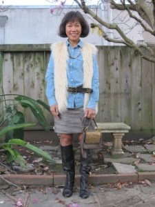 My disheveled western look, accented with brass and crystal necklace, and studded belt and crossbody purse from Sundance.