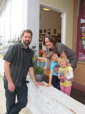 The Komaromi-O'Neil family greets customers at the entrance of Jenny K.