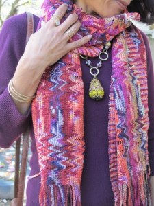 A plum-colored sweater gets a boost with a Missoni scarf and bold Pam Hiran necklace (Anthropologie).