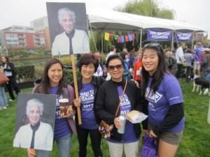 Alzheimer's Association's End Alzheimer's Walk in San Francisco: Elisha Bonny (Tsai's daughter), Tsai, Liou, and Christina (Liou's daughter), carrying photos of Tsai's grandmother, who died from Alzheimer's disease, October 2012. (Photo courtesy of Tsai)