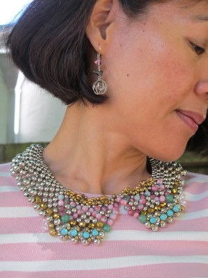 A close-up of the bejeweled collar (Anthropologie) and Carmela Rose bird and sphere earrings.