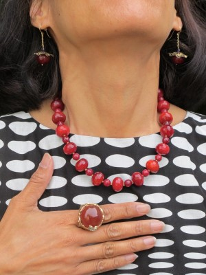 Go for the jugular with blood-red carnelian earrings and necklace by Carmela Rose and Juicy Couture ring.