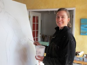 Tana Hakanson works on a painting at her home studio in the Richmond Annex.