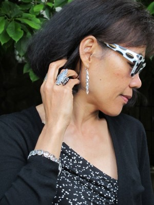 These statement sunglasses are the centerpiece of the accessories.