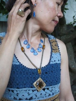 Vintage earrings and necklaces and Lava 9 ring (Berkeley, CA) play up the colors of the crocheted dress.