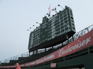 The hand-turned scoreboard doesn't include all the teams in order to retain its original form.