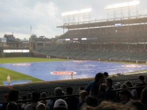 Wind and rain descend delaying the game for three hours.