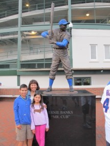 "Posing with Hall-of-Famer Ernie Banks, who dubbed Wrigley Field ""the Friendly Confines."""