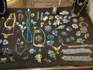 Display cases are brimming with mid to late 20th century costume jewelry.