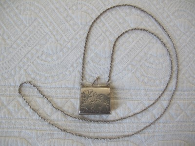 Sterling silver miniature etched purse on a long sterling silver chain.