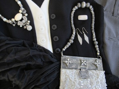 Black-and-white foundation accessorized with Sundance necklace, Tiffany mesh earrings and ring, and The Fickle Bag's embellished purse.