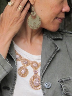 Worn and old favorites: Embellished t-shirt, army-green jacket, zebra skirt, and Sundance slippers and hobo handbag, with earrings from art bazaar in NYC, Sundance ring and bands, and In God We Trust double band (NYC).