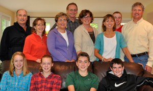 Linda Beal (middle row, fourth from left) of Kids Five and Over.