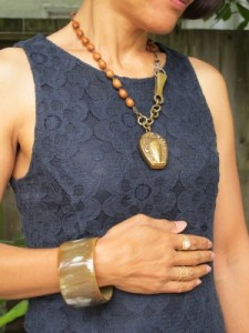 Bold accessories on navy lace: Horn cuff from Kenya, a present from my sister Heidi; Sundance rings; In God We Trust banded ring (NYC); and reclaimed vintage matchbox and rosary necklace by Ren Lux Revival (Uncommon Objects, Austin).
