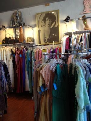 Racks of vintage clothing.